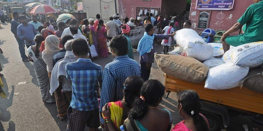 Vijayawada Andhra Pradesh Public waiting in line for Onions at Patamata raitu bazar in Vijayawada on Saturday.