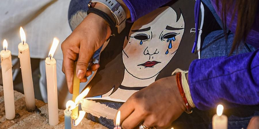 A candlelight march demanding justice for rape victims underway at UP Bhawan in New Delhi.