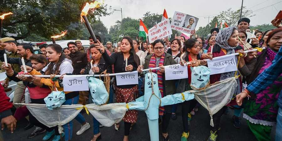 Activists during a candlelight march in solidarity with rape victims and to highlight the issue of violence against women in the country at ITO in New Delhi