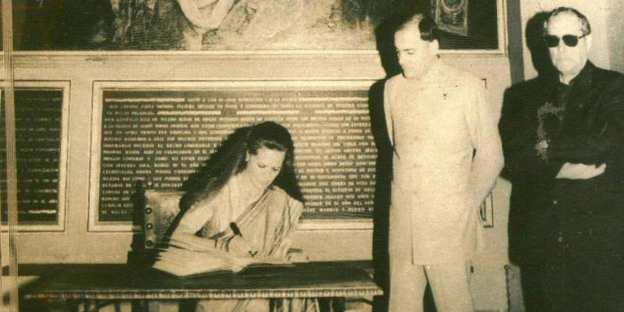 Then PM Rajiv Gandhi and his wife Sonia Gandhi visited the historic Cathedral. Photo taken on the occassion shows Sonia Gandhi giving her remarks in the visitors' book with Rajiv Gandhi looking on.