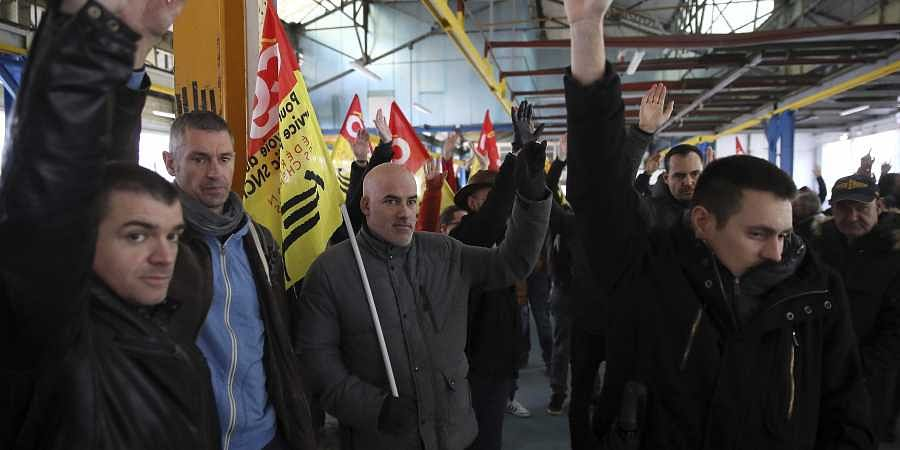 Railway workers gather during a meeting of the CGT and Sud Rail unions in Rennes, western France, Monday, Dec. 9, 2019. Unions launched nationwide strikes and protests over the government's plan to overhaul the retirement system. Paris commuters inched to