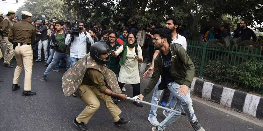 Police personnel lathi charge on JNU students during a protest against the fee hike issue, in New Delhi on Monday. (Photo | Parveen Negi/EPS)
