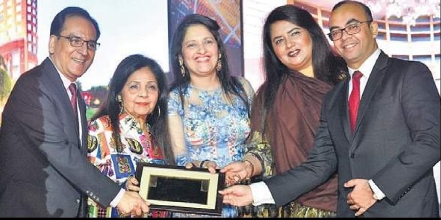 (Second from left) Satish Bala Malhotra, Chairperson of MBD Group, with her team