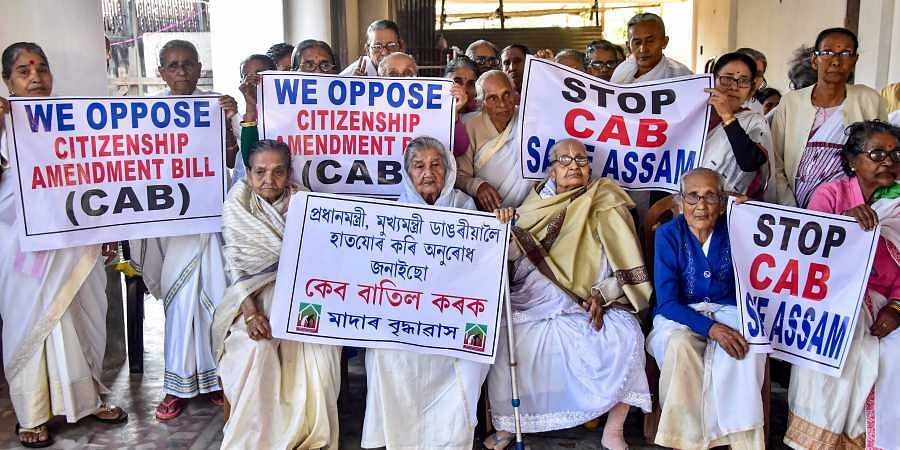 Elderly women from an old-age home take part in a protest against Citizenship Amendent Bill in Guwahati Monday