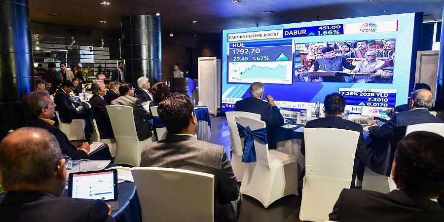 Business leaders watch the live telecast of the interim Budget presentation on a giant screen during a budget viewing session at a hotel in New Delhi. (Photo | PTI)