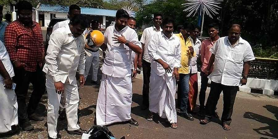 TheLeader of the legislature wing of the AIADMK A Anbalagan and his colleagues in the Assembly A Baskar and Vayyapuri Manikandan brought a helmet each and smashed them on the floor.