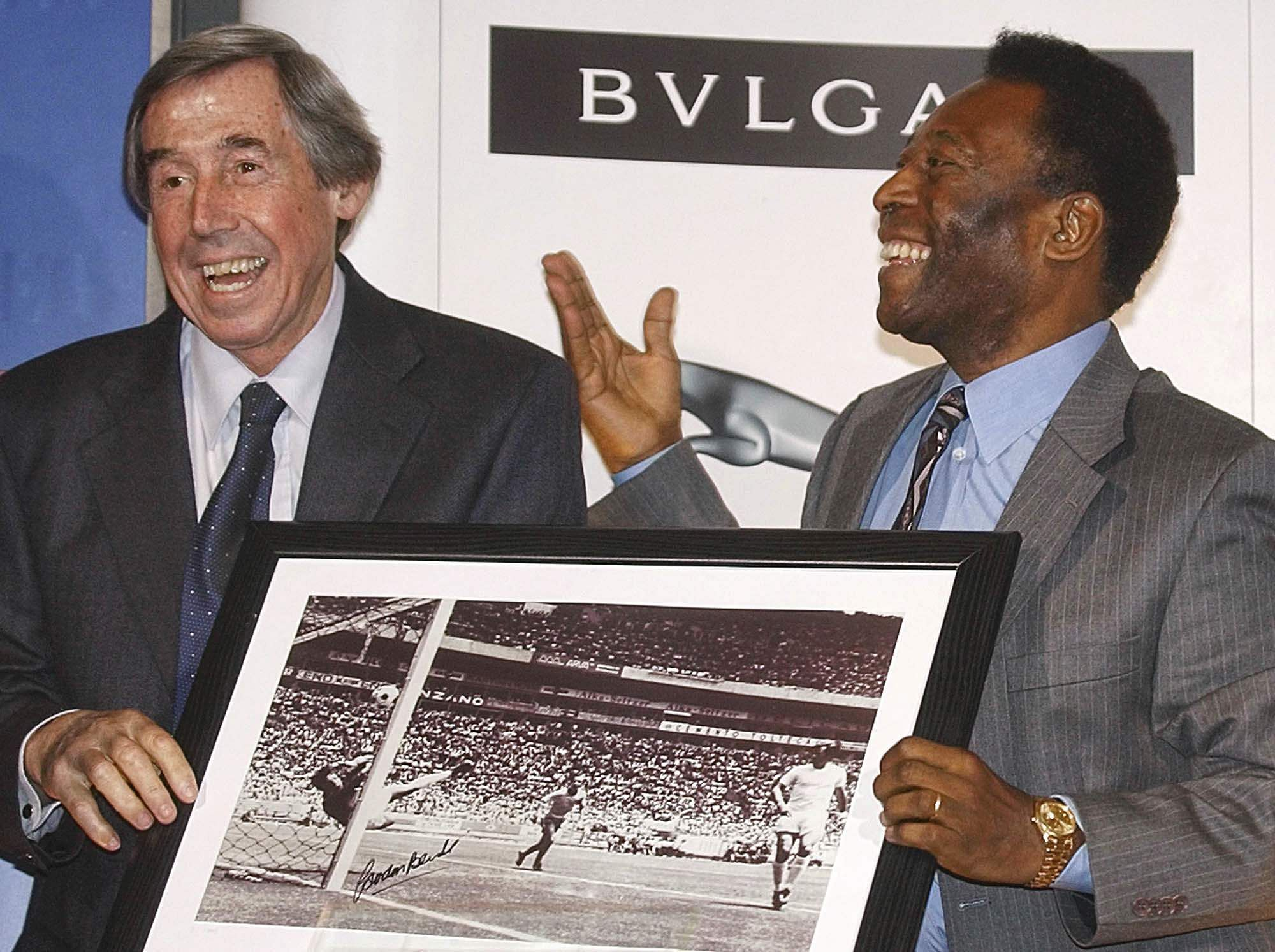 In this Thursday March 4, 2004 file photo Brazilian soccer legend Pele, right, presents former England goalkeeper Gordon Banks with a photograph showing Banks saving a header from Pele in the 1970 World Cup, at a press conference in London, to mark FIFA's 100 year anniversary.