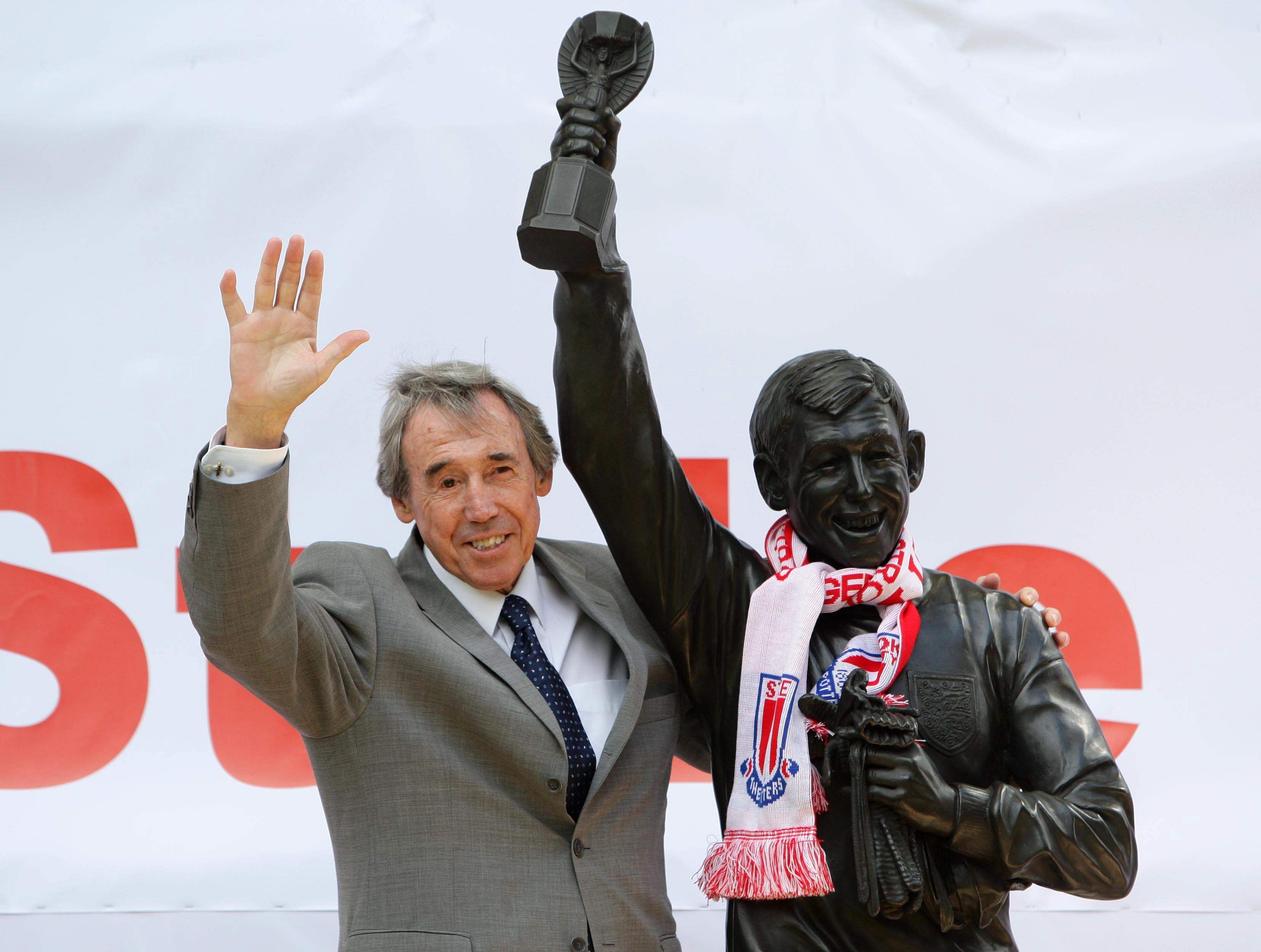 In this July 12, 2008 file photo former England soccer goalkeeper Gordon Banks stands next to the new Gordon Banks statue at the Britannia Stadium in Stoke, England.