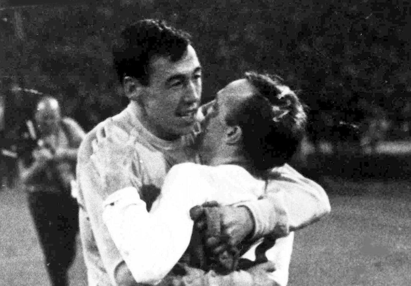 In this July 26, 1966 file photo England's goalkeeper Gordon Banks, left, hugs midfielder Nobby Stiles after the World Cup semi-final soccer match played at Wembley, London.