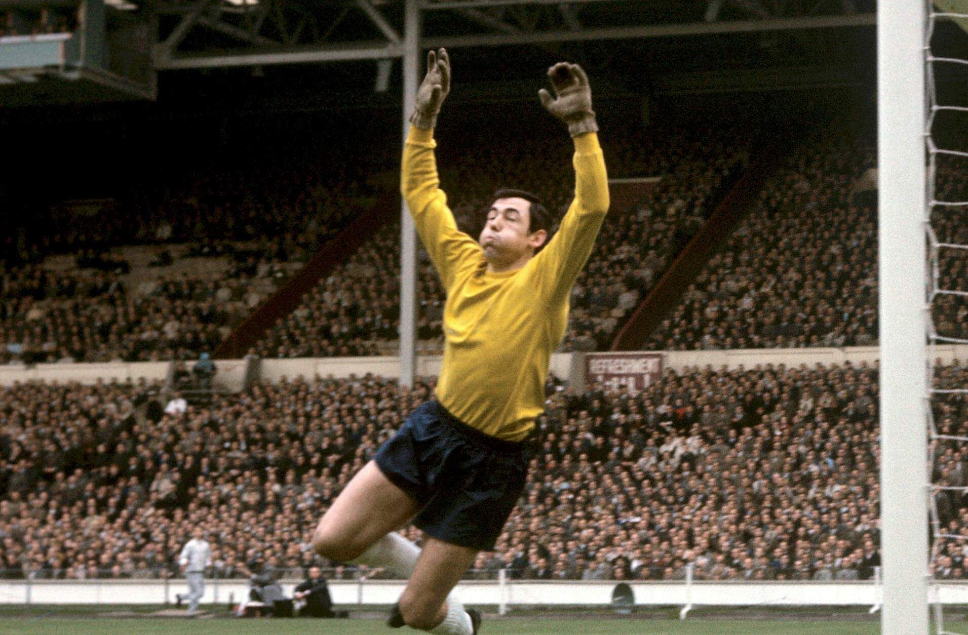 In this May 5, 1965 file photo Gordon Banks jumps to make a save in a soccer match against Hungary at Wembley stadium in London.