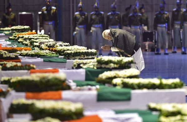 Prime Minister Narendra Modi pays tribute to the martyred CRPF jawans who lost their lives in Thursday's Pulwama terror attack after their mortal remains were brought at AFS Palam in New Delhi Friday Feb 15 2019.   PTI