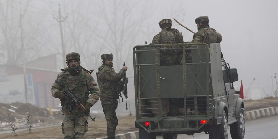 Indian army soldiers arrive at the site of Thursday's explosion in Pulwama.