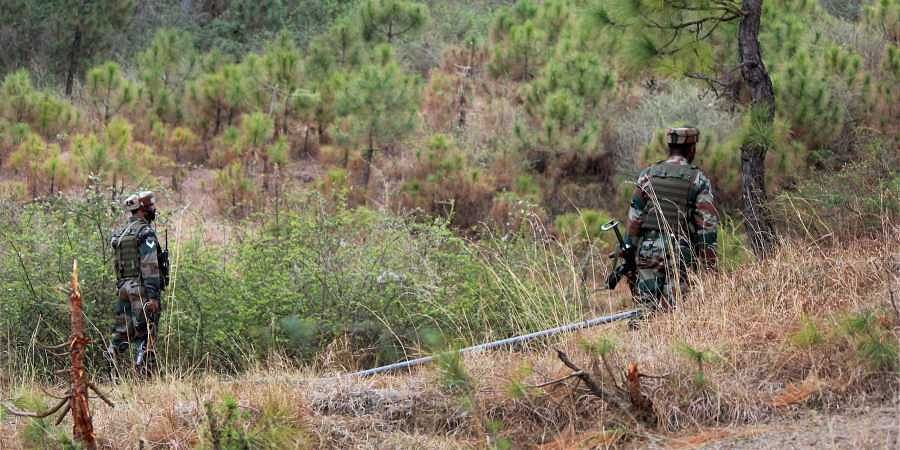 Indian army soldiers patrol near the Line of Control