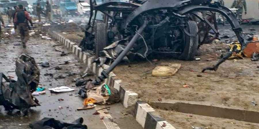 A scene of the spot after militants attacked a CRPF convoy in Goripora area of Awantipora town in Pulwama district Thursday Feb 14 2019.
