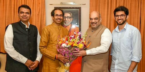 BJP chief Amit Shah (R) and Shiv Sena chief Uddhav Thackeray (L).   (File   PTI)