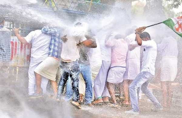 The police using water guns on the Youth Congress activists who took out a march to the Secretariat in protest against the killing of two Congress workers in Kasargod |  Vincent Pulickal