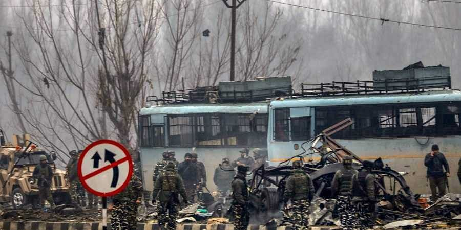 Soldiers at the suicide bomb attack site in Kashmir's Pulwama district.