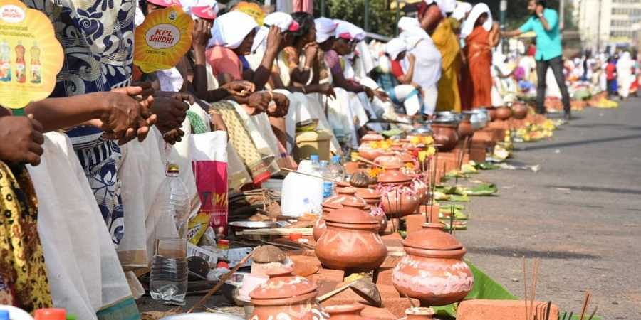 Devotees Across The City Lit Small Hearths They Had Set Up Along Road To Cook Rice And Jaggery Photo
