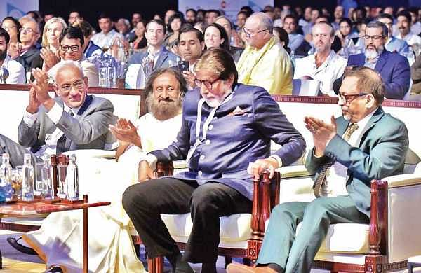 Amitabh Bachchan is applauded as he gets up to deliver his speech at the 44th IAA World Congress, which began at the Grand Hyatt, Bolgatty in Kochi, on Wednesday. From left: Srinivasan K Swamy, chairman and MD of RK Swamy BBDO Pvt Ltd; Sri Sri Ravi Shankar and Pradeep Guha, MD, 9X Media Pvt Ltd | Albin Mathew