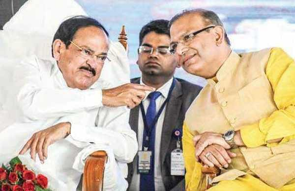 Vice-President Venkaiah Naidu with Minister of State for Civil Aviation Jayant Sinha at Tirupati Airport on Wednesday | Madhav K