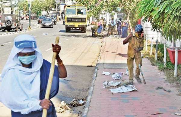 Sanitation workers of City Corporation cleaning the streets after the Attukal Pongala on Wednesday | B P Deepu