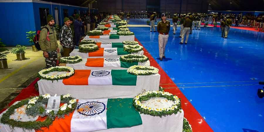 Mortal remains of CRPF jawans who lost their lives in Thursday's Pulwama terror attack during a tribute paying ceremony at AFS Palam in New Delhi Friday Feb 15 2019.