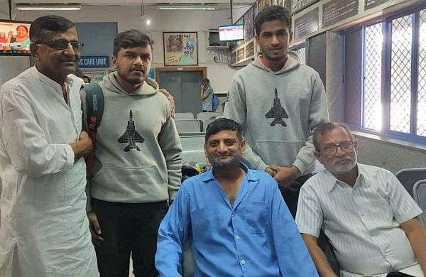 Wing Commander Vijay Shelke (in blue shirt) and his family meet Chethan Kumar (second from left) at a hospital in Bengaluru on Friday. (Photo