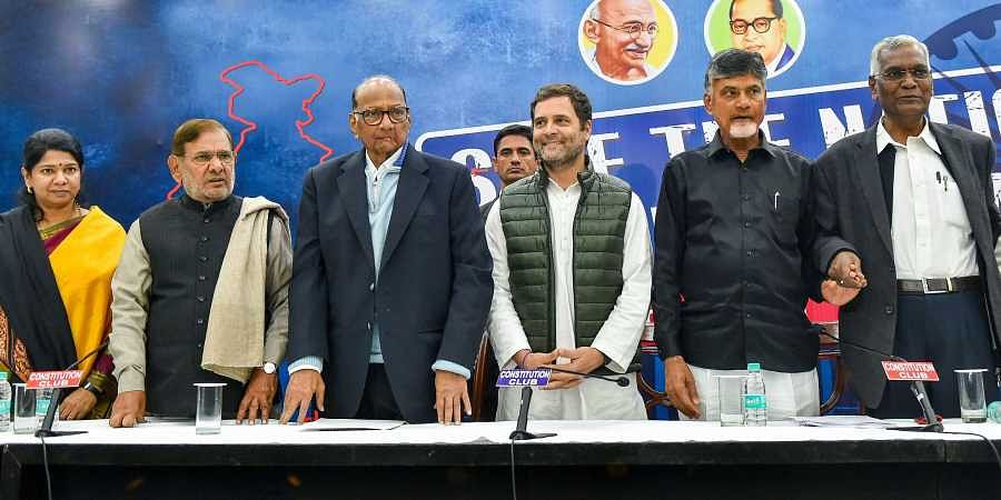 Congress President Rahul Gandhi with TDP chief N Chandrababu Naidu NCP President Sharad Pawar CPI's D Raja Sharad Yadav SP's Ram Gopal Yadav and DMK leader Kanimozhi at a press conference after the opposition parties' meeting over various political issues