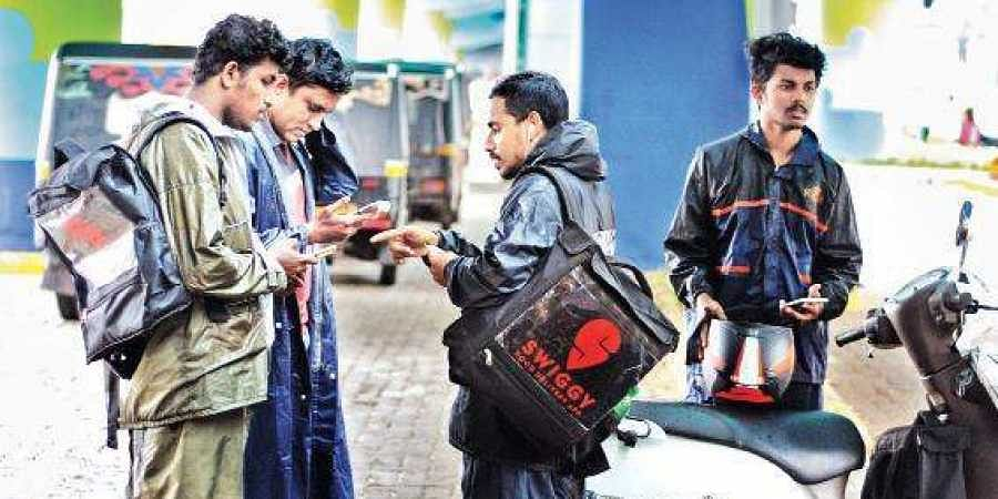 Many young men are cashing in on the popularity of online food delivery apps by turning delivery guys l With incentives and health insurances, they are offered a good deal, swiggy, kochi, EPS