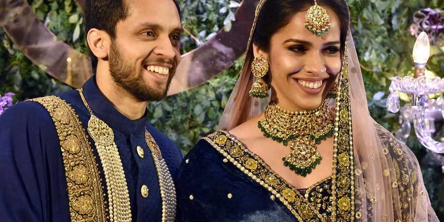 Newlyweds Saina Nehwal and Parupalli Kashyap hosted a grand reception party in Hyderabad. (Photo | PTI)