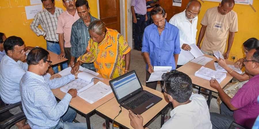 People check their names on the final draft of Assam's National Register of Citizens after it was released at a NRC Seva Kendra Hatigaon in Guwahati.