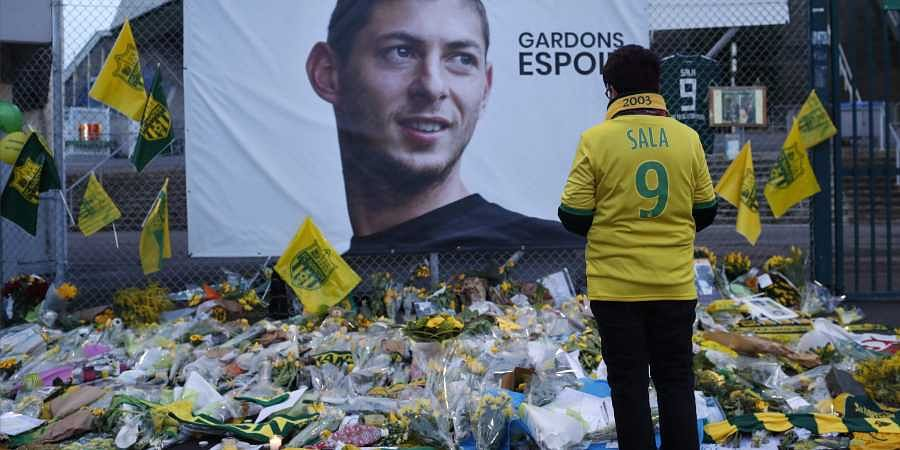 Nantes supporters stops by a poster of Argentinian player Emiliano Sala
