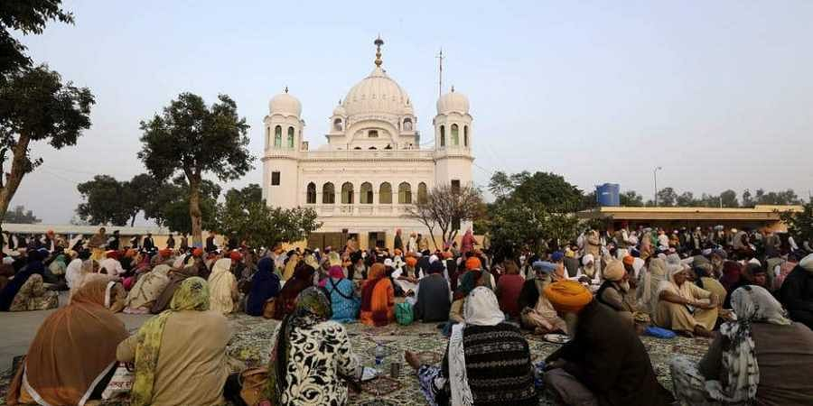 Sikh pilgrims at the shrine for Guru Nanak Dev in Kartarpur, Pakistan ( Photo   The Coversation.com)