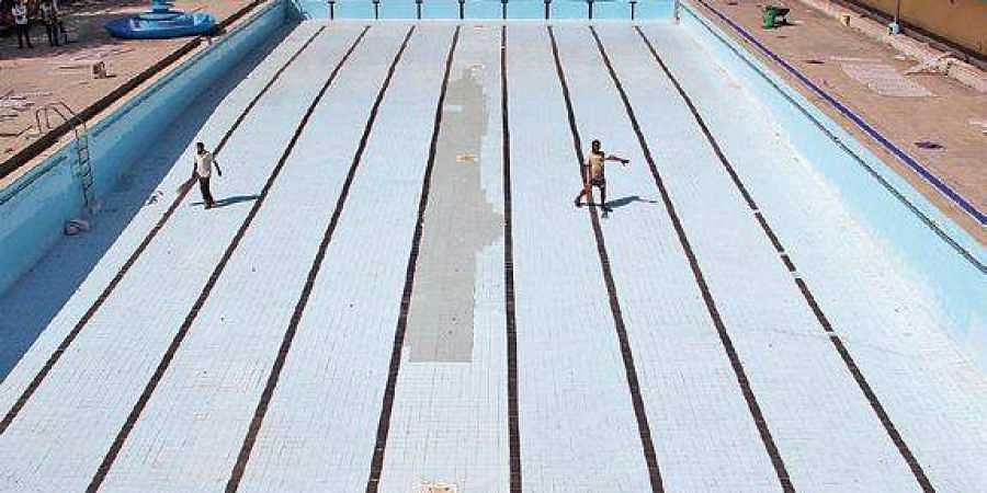 Summer here but ghmc yet to open swimming pools for public the new indian express for Swimming pool maintenance in hyderabad