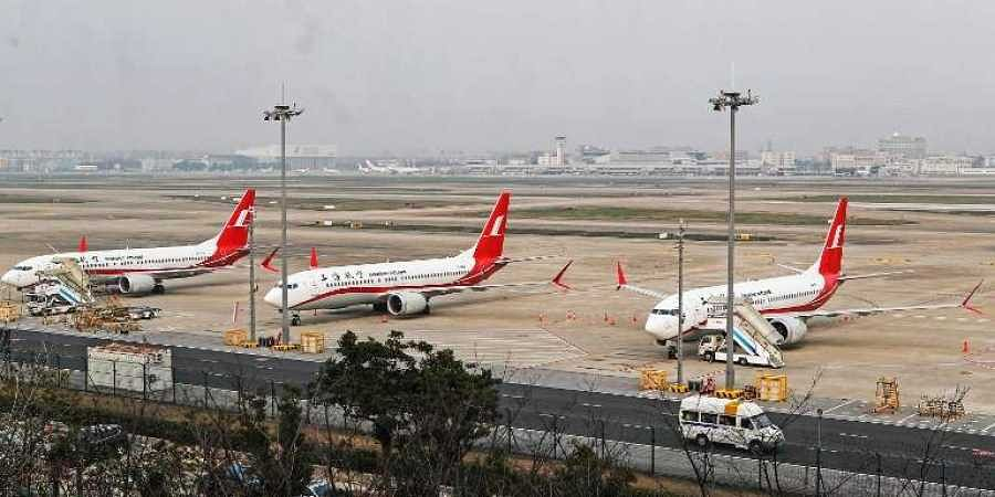 This photo taken on March 11, 2019 shows three Boeing 737 MAX 8 planes from Shanghai Airlines parked at Shanghai Hongqiao International Airport in Shanghai. (Photo | AFP)