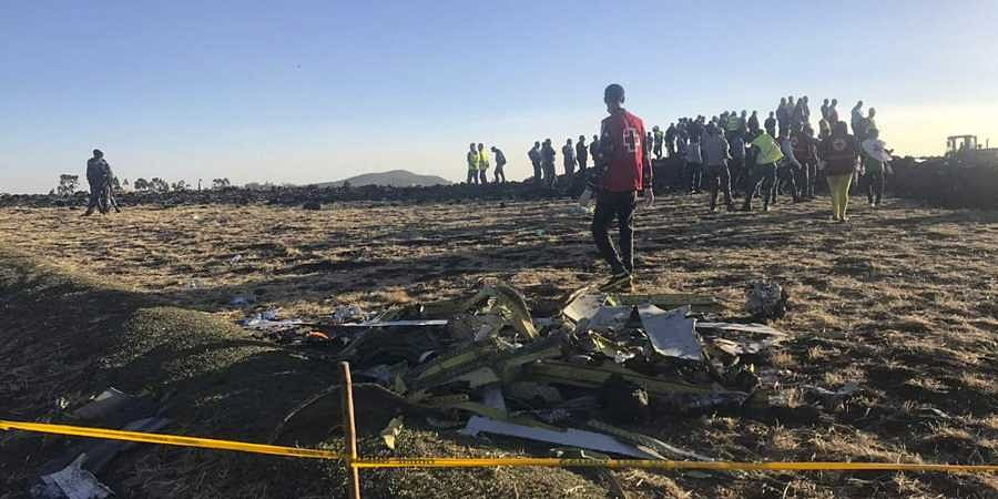 Rescuers search at the scene of an Ethiopian Airlines flight that crashed shortly after takeoff at the scene at Hejere near Bishoftu, or Debre Zeit, some 50 kilometers (31 miles) south of Addis Ababa, in Ethiopia. (Photo | AP)