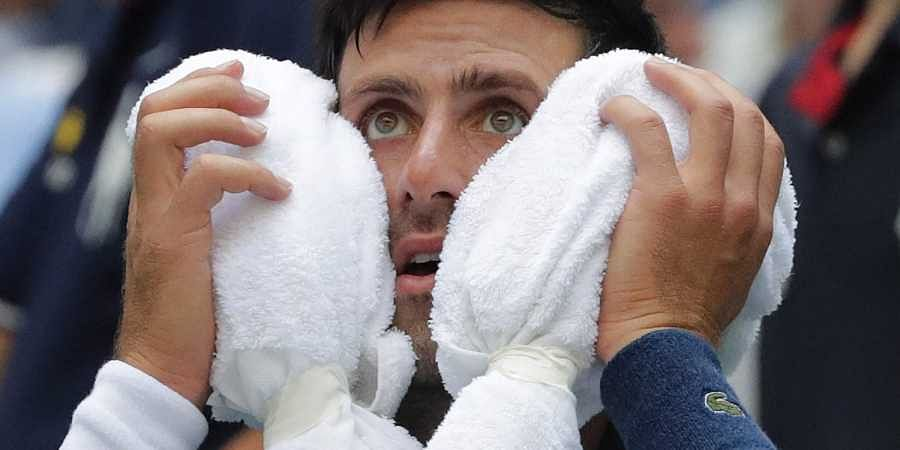 Defeated Djokovic will regroup at the double