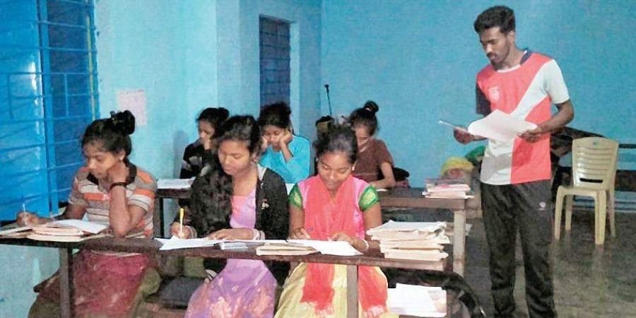 SSLC students attend a night class at a government school in Bogase village in Chikkamagaluru district.