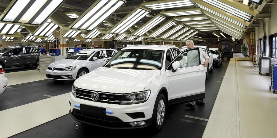 Employees work at the production line of Volkswagen Tiguan cars in the Volkswagen plant in Wolfsburg, Germany. (File   AP)