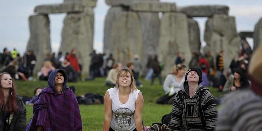 People gather at the ancient stone circle Stonehenge, during the Summer Solstice, the longest day of the year, in Wiltshire. (File | AP)