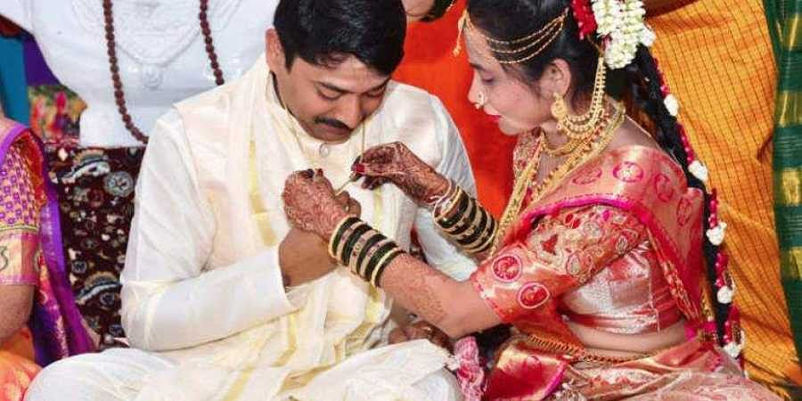 One of the couples at the unusual wedding in Karnataka where the bride tied the mangalsutra, and not the groom! (Video screengrab)