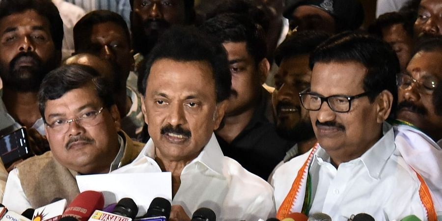 DMK President M K Stalin reads out the letter of agreement arrived between Congress and DMK in connection with the upcoming Parliament Elections at Anna Arivalayam in Chennai.