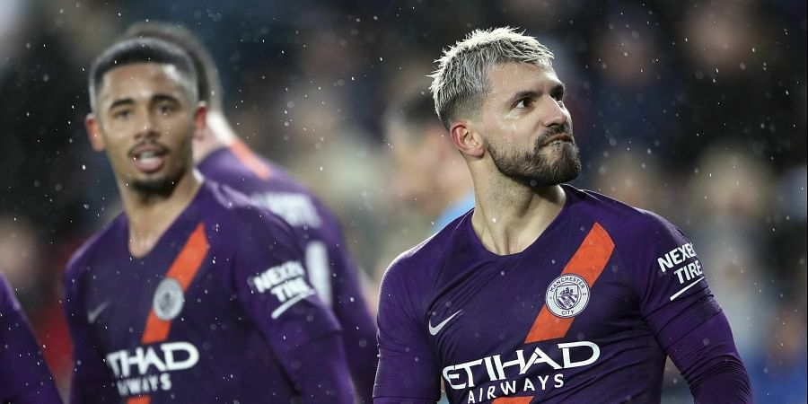 Man City fight back to keep quadruple bid alive