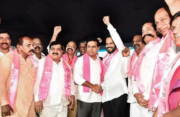 TRS working president KT Rama Rao welcomes P Karthik Reddy into the pink party on Tuesday | Express