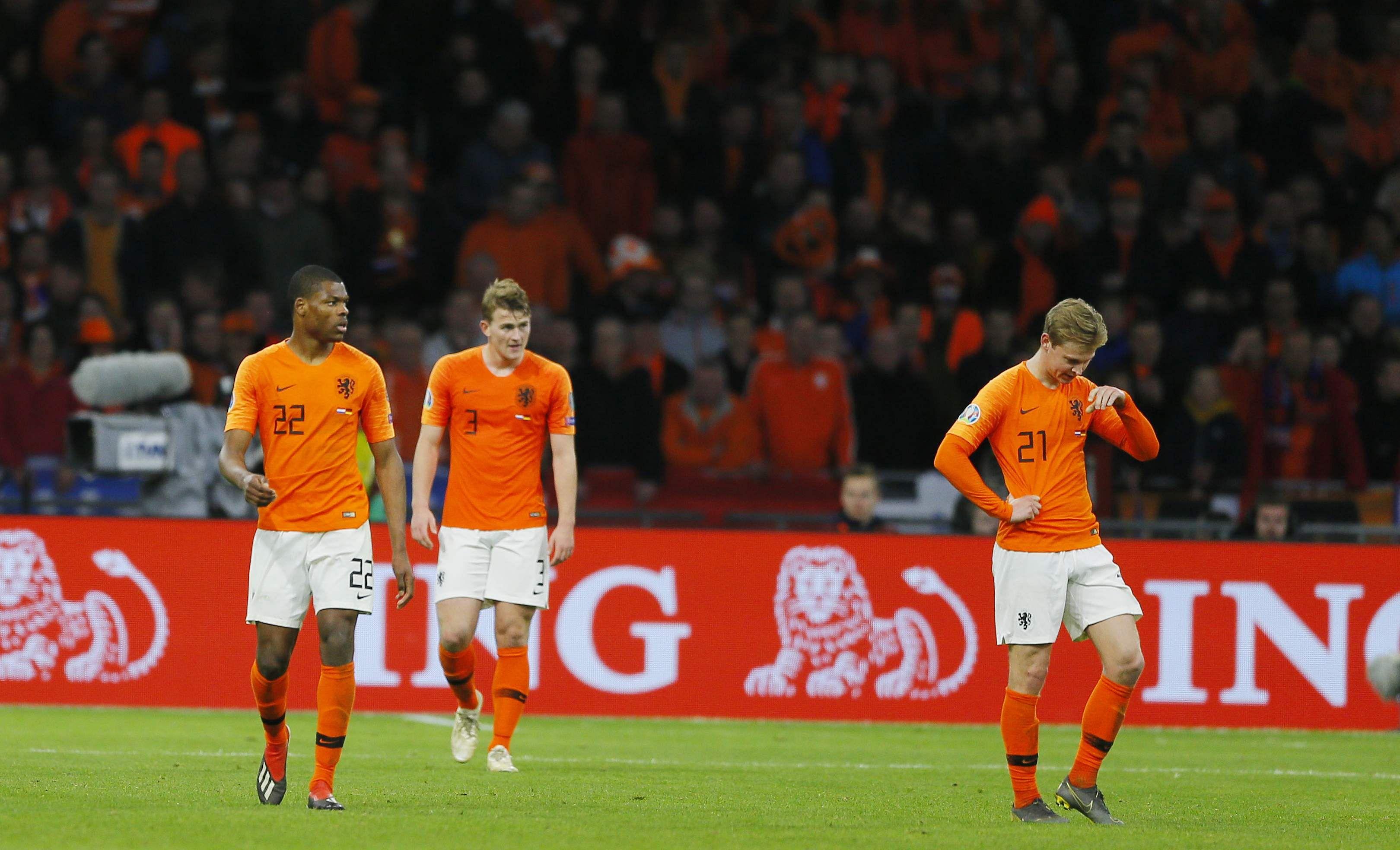 From left, Netherlands' Denzel Dumfries, Netherlands' Matthijs De Ligt and Netherlands' Frenkie de Jong