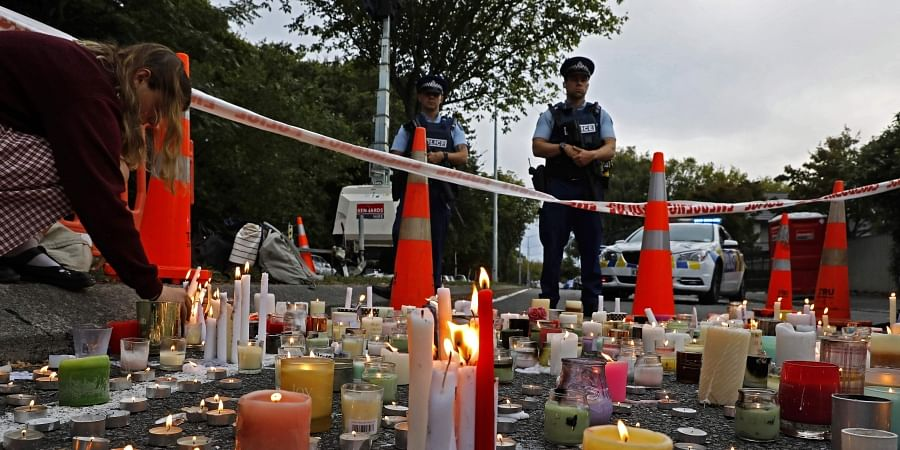 FILE - In this March 18, 2019, file photo, a student lights candle during a vigil to commemorate victims of March 15 shooting, outside the Al Noor mosque in Christchurch, New Zealand. (Photo | AP)