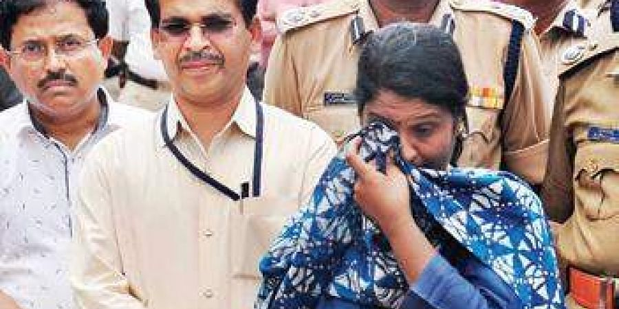DC Deepa Cholan breaks down at the building crash site on Monday
