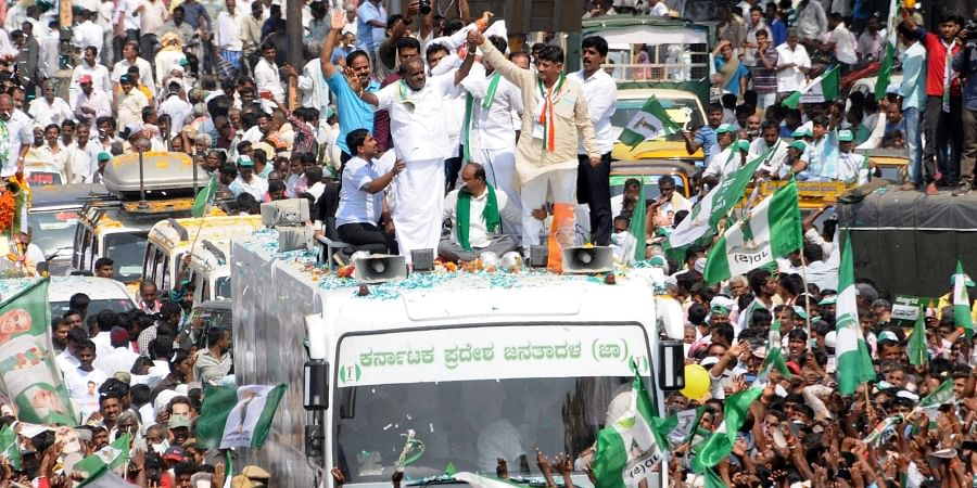 Chief Minister HD Kumaraswamy and Minister DK Shivakumar accompanying Nikhil Kumaraswamy the JD(S) - Congress Coalition candidate for Mandya LS Constituency as he proceeded in a procession to file his nomination at Mandya on Monday