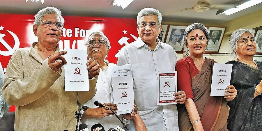 CPI(M) General Secretary Sitaram Yechury,  former general secretary Prakash Karat and other leaders release the party's manifesto for the upcoming Lok Sabha elections at a press conference, in New Delhi on Thursday.