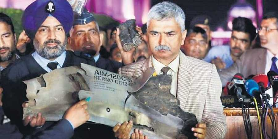 Indian Air Force officials display a piece of an AMRAAM missile, from a Pakistani Air Force F-16 jet, during a press conference at South Block in New Delhi on Thursday.
